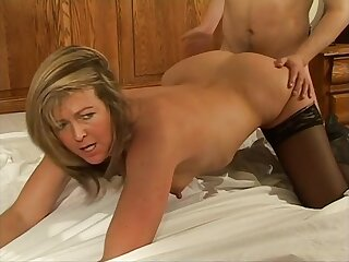 Horny wife Alex in stockings gets fucked hard on the bed and loves it